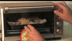 Modern electrinic oven. Someone is opening the door and checking if fish piaces Arkistovideo