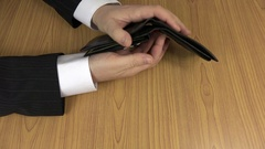 Man in suit hands check empty black leather wallet purse. 4K Stock Footage