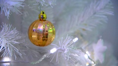 Christmas ball on tree with bright illuminations. Stock Footage