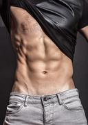 Close up, man ripped fit slim abs, core, t-shirt. Stock Photos
