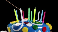 Light fires colored happy birthday candles Stock Footage