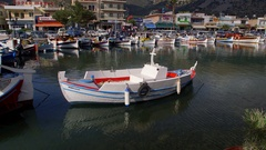 ROWING BOAT IN HARBOUR ELOUNDA CRETE GREECE Stock Footage