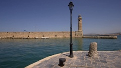 HARBOUR WALL LIGHTHOUSE RETHYMNON CRETE GREECE Stock Footage