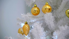 Background with  golden decoration balls and cones on the Christmas tree. Stock Footage