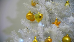 Background with golden balls and cones on the Christmas tree. Stock Footage