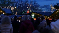 Vienna Christmas markets with people and christmas tree - in night, slow motion Stock Footage