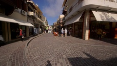 POLICE CAR COBBLED SHOPPING STREET RETHYMNON CRETE Stock Footage