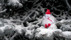 Christmas background Snowman sitting on snow-covered branches of a Chr Stock Footage