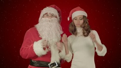 Santa claus dance with Attractive Christmas lady on red background with snow Stock Footage