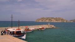 TOURIST BOATS SPINALOGKAS PLAKA CRETE GREECE Stock Footage