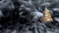 Christmas background with golden bells on the Christmas tree Stock Footage
