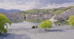 Aerial shot of idyllic lake at St Bathans, New Zealand Stock Footage
