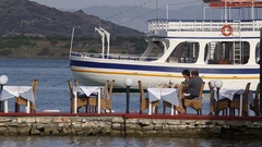 PEOPLE EATING OUTSIDE ELOUNDA CRETE GREECE Stock Footage