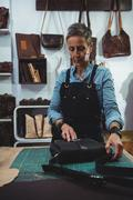 Attentive craftswoman working Stock Photos