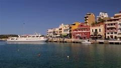 TOURIST BOAT IN HARBOUR AGIO NIKOLAOS CRETE GREECE Stock Footage