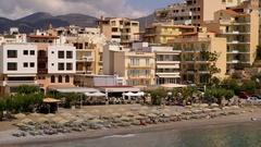 BUILDINGS EASTERN BAY BEACH AGIOS NIKOLAOS CRETE Stock Footage
