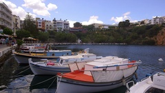 PLEASURE BOATS ON LAKE AGIOS NIKOLAOS CRETE GREECE Stock Footage