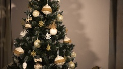 Teen girl decorate chrismas tree Stock Footage