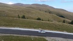 Porsche 911 on a mountain road Stock Footage