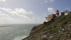 Lighthouse before the storm at Cape Cabo sao Vicente. Portugal Sagres Stock Footage