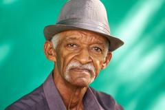 People Portrait Serious Elderly African American Man With Hat Stock Photos