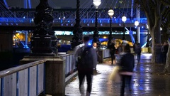 The romantic South Bank of River Thames in London by night - time lapse shot Stock Footage
