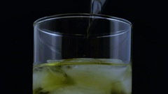 Macro dropping dry ice into drink Stock Footage