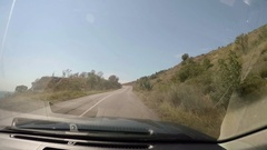 View from moving car on coastal road. Trees, beaches, sea, bay. Crimea Stock Footage