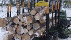 Forest in winter, forwarder transporting wood out Stock Footage