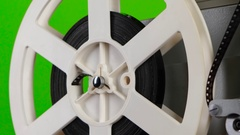 Detail of the projector turns the film. Close up Stock Footage