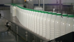 Plastic Bottles with milk at a dairy factory moving on conveyor Stock Footage