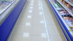 Supermarket shelves and blank rows without buyers Stock Footage