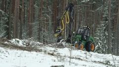 Forest in winter, forwarder processing the wood Stock Footage