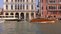 WATER TAXIS GONDOLAS GRAND CANAL VENICE ITALY Stock Footage