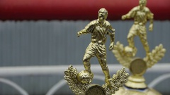 Football trophy, awards for competitions Champions League Golden statuette Stock Footage