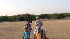 Tourists ride a Camel in Jaisalmer, India Stock Footage