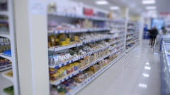 Supermarket shelves with goods, buyers go shopping choose products Stock Footage