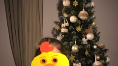 Teen girl with christmas props mask of chicken Stock Footage