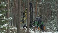 Video of a working forwarder inside the forest in winter Stock Footage