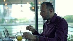 Young man getting stomach ache during meal in cafe Stock Footage