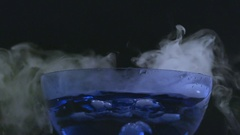 Small clouds of smoke rise form bubbling bowl in slow motion Stock Footage
