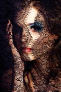 Portrait of beauty young woman through lace close up mistery mak Stock Photos