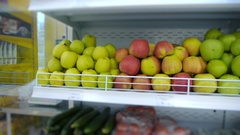 Organic fruits and vegetables on the supermarket shelf Stock Footage