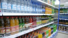 Fizzy drinks on the supermarket shelf, blurry Stock Footage