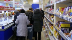 Sale of goods in the supermarket, a lot of buyers walk the rows in the store Stock Footage