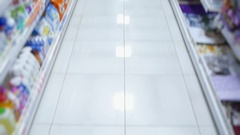 Empty aisle of a supermarket with goods for purchase Stock Footage