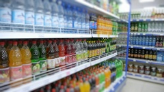 Shelf of sodas in the supermarket, blurred Stock Footage