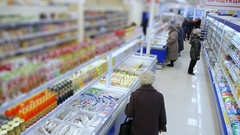 Supermarket shelves with goods, buyers choose food Stock Footage