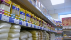 Supermarket food on the shelves blurry Stock Footage