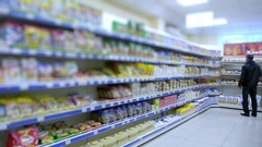 Goods on supermarket shelves. blurry Stock Footage